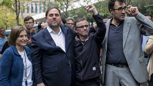 Carme Forcadell y Oriol Junqueras, junto a Josep Maria Jové y Lluís Salvadó, el 20 de septiembre del 2017.