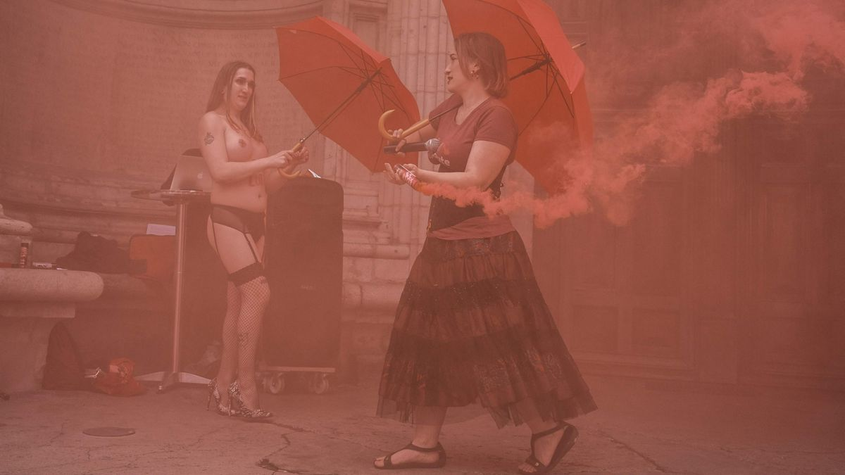 EDITORS NOTE: Graphic content / Prostitutes take part in a happening action to mark the international day of the sex workers and to protest against the 2016 French law on prostitution, in front of the Saint-Nizier church, emblematic of their fight on June 2, 2021, in Lyon. (Photo by JEAN-PHILIPPE KSIAZEK / AFP)